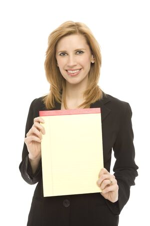 A businesswoman in a suit holds a yellow pad of legal paper against a white background Stock Photo