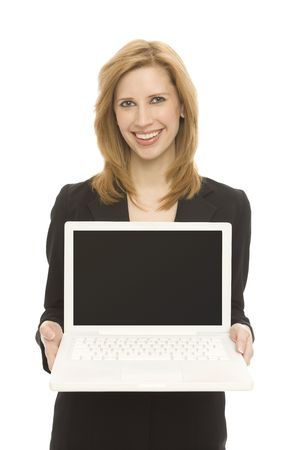 A businesswoman in a suit holds up a laptop against a white background
