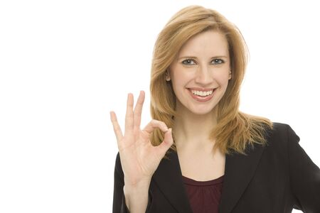 Businesswoman in a suit gestures positively against a white background Stock Photo
