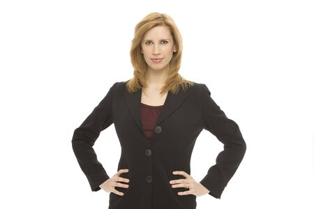 Businesswoman in a suit stands confidently against a white background