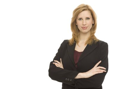 Businesswoman in a suit stands confidently against a white background Stock Photo - 1229052