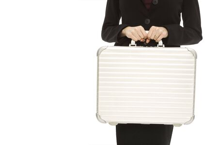 Businesswoman in a suit holds a metal briefcase