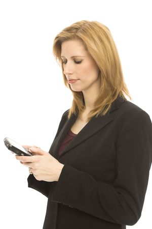 Businesswoman texts with her thumbs on a mobile device