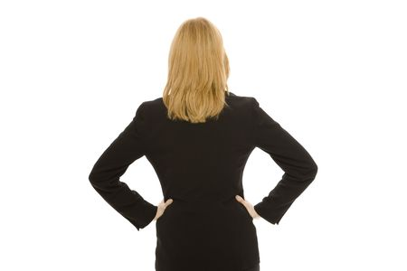 Businesswoman in a suit faces away against a white background