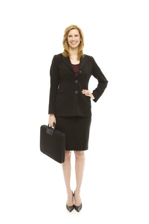 Businesswoman in a suit holds a briefcase Stock Photo
