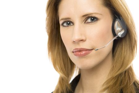 Businesswoman in a suit uses a modern headset