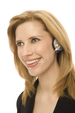 Businesswoman in a suit smiles and uses a headset Stock Photo - 1228503