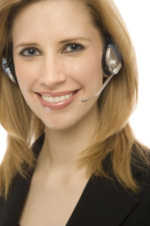 Businesswoman in suit happily uses a headset