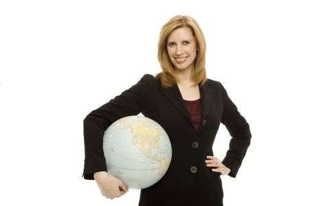 Businesswoman in a suit holds a globe with confidence
