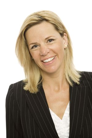 Blonde businesswoman in a suit smiles against a white background Stock Photo - 1228414