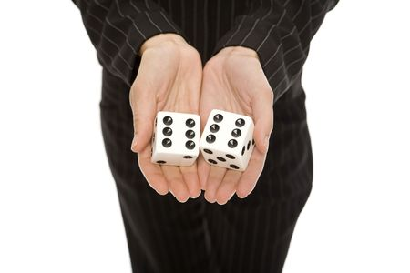 Woman in a pinstripe suit holds a large pair of dice Stock Photo