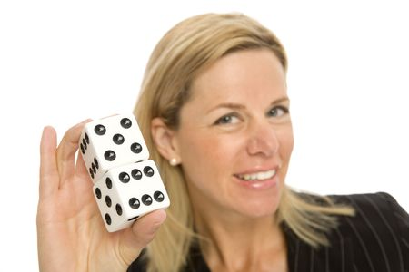 A blonde woman holds up a large pair of dice Stock Photo