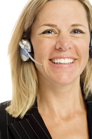 Businesswoman with headset smiles against a white background Stock Photo - 1229068