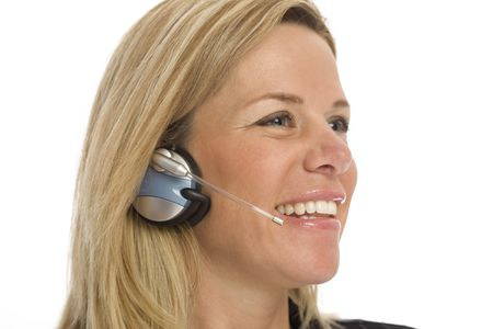 Woman with headset smiles against a white background Stock Photo - 1229070