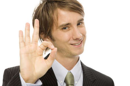 Businessman in a suit gestures ok with his fingers