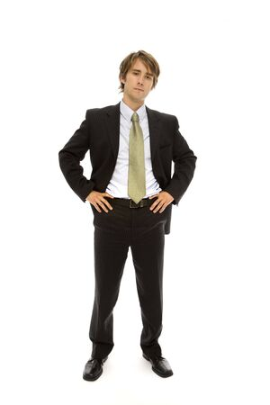 A businessman in suit stands with confidence Stock Photo