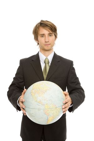 Businessman in a suit holds up a globe