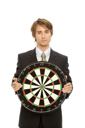 Businessman in a suit holds up a target