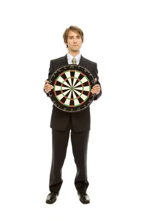 Businessman in a suit stands holding a target