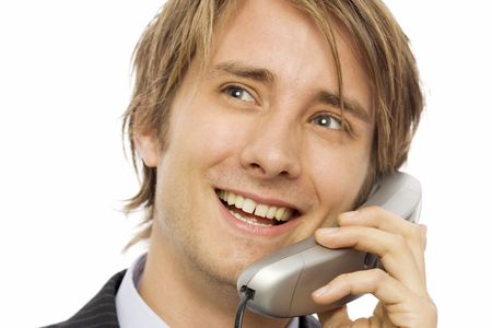 Businessman in a suit uses a corded telephone