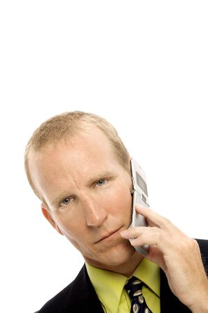 Businessman in a suit uses a cellular phone Stock Photo