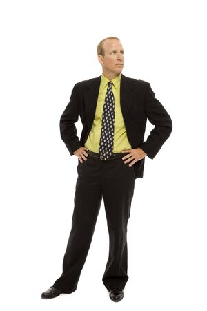 hand on hip: Businessman in a suit stands with confidence