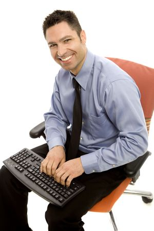 masculin: Businessman sits in a chair with a keyboard