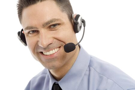 Businessman smiles as he uses a headset