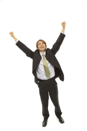 Businessman in a suit raises his arms in triumph