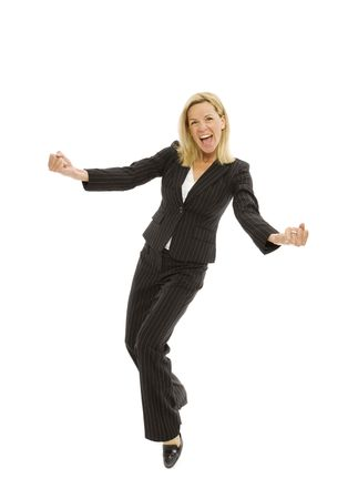 A businesswoman in a suit dances with excitement