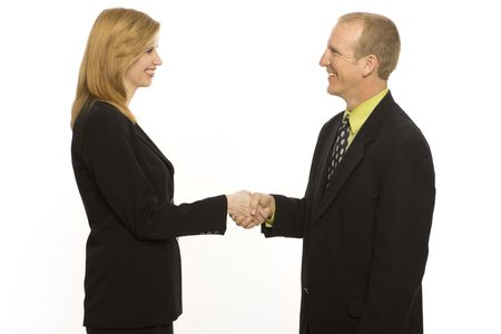 Two business people shake hands Stock Photo
