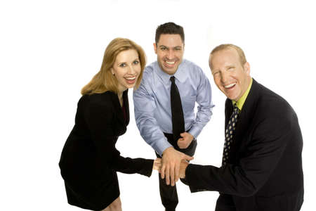 Three business people gesture teamwork with their hands