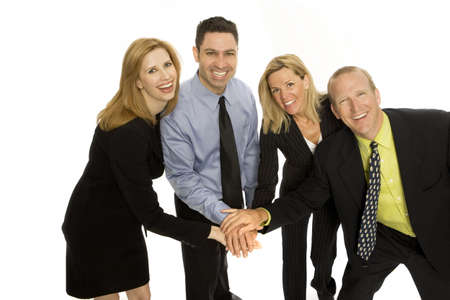 Four business people gesture teamwork