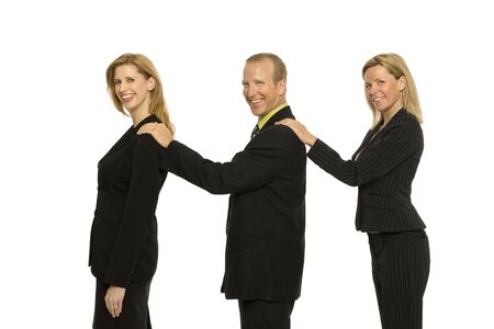 Three business people stand together Stock Photo