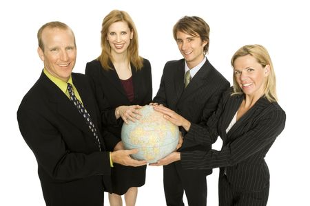 Four business people hold a globe together Stock Photo