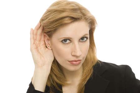 Businesswoman listens Stock Photo