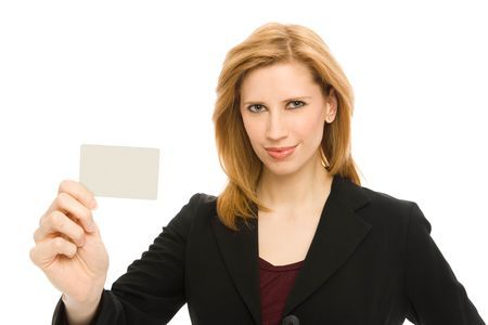 Businesswoman holds up a credit card confidently