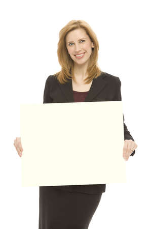 A businesswoman holds a yellow board