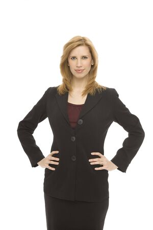 A businesswoman in a suit stands confidently