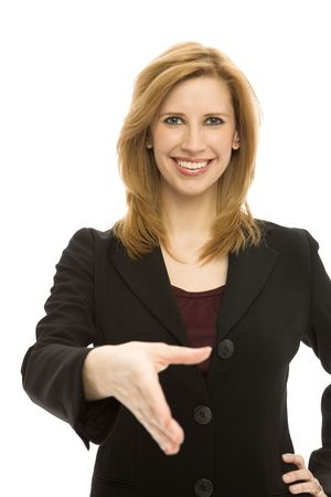 Businesswoman in a suit gestures a handshake and smiles Stock Photo