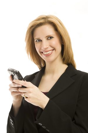 Businesswoman texts on a mobile device and smiles Stock Photo