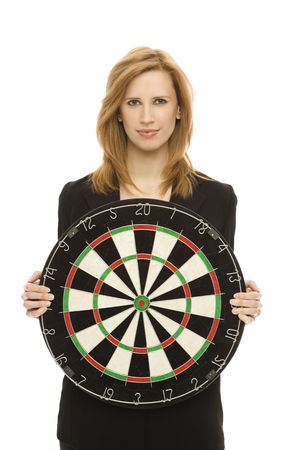 Businesswoman in a suit holds a dart board photo