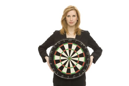 Businesswoman in a suit holds a dart board Stock Photo - 1229157