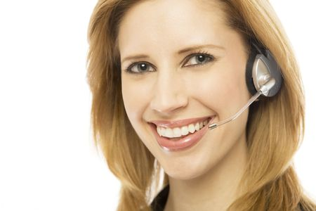 Businesswoman in a suit smiles and uses a headset