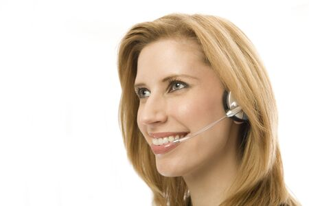 Businesswoman in suit happily uses a headset photo
