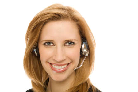 Businesswoman in a suit happily uses a headset photo