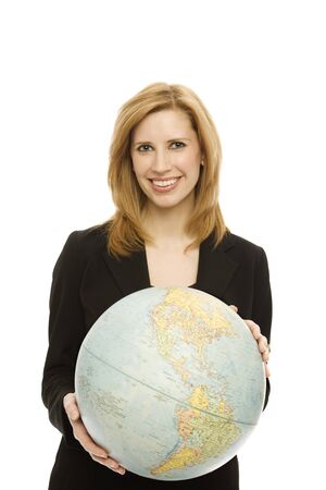 Businesswoman in a suit holds a large globe photo
