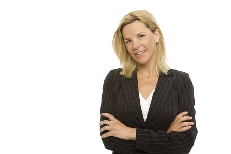 Blonde businesswoman crosses her arms with confidence Stock Photo