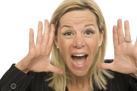 Businesswoman in a suit yells and gestures with her hands