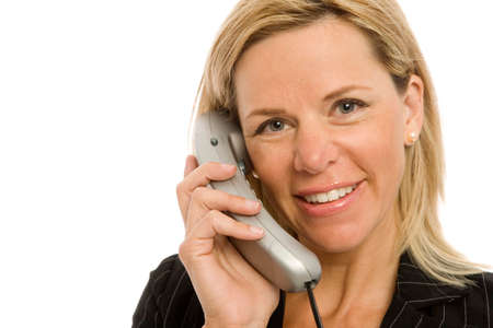 Businesswoman in a suit uses a corded telephone Stock Photo